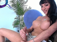 Spend a lot of nice time with beautiful tranny Mia Isabella. Hottie stays in high heeled shoes before starting to stroke big cock pushing huge dildo into her anal hole.