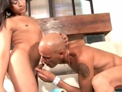 Bald guy kisses and blows sexy tranny